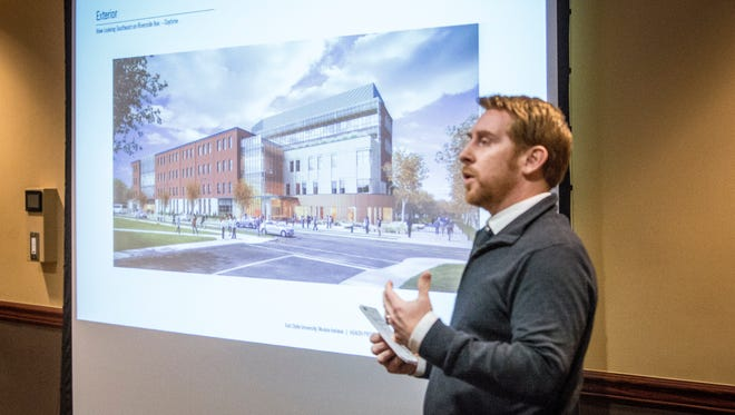 Architect Brock Roseberry of  Ratio unveils a drawing of the front elevation of Ball State University's new health professions building.