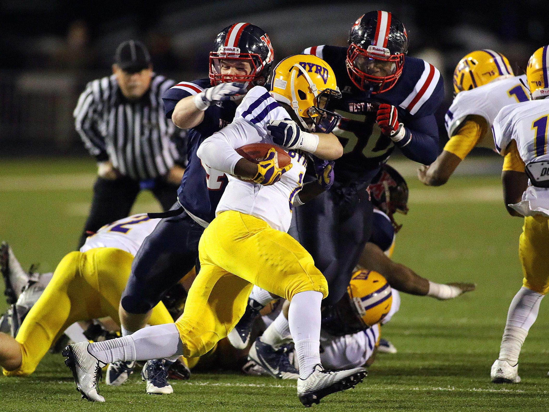Byr quarterback Deuce Caston looks for running room against West Monroe in the Class 5A quarterfinals last season.