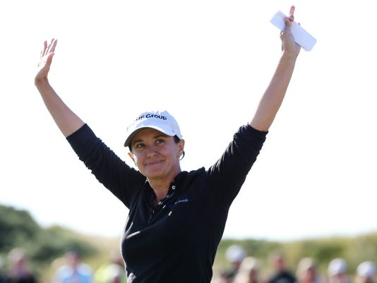 Mo Martin of the U.S celebrates after winning the Women's British Open golf championship at the Royal Birkdale Golf Club, in Southport, England, Sunday, July 13, 2014. (AP Photo/Scott Heppell)