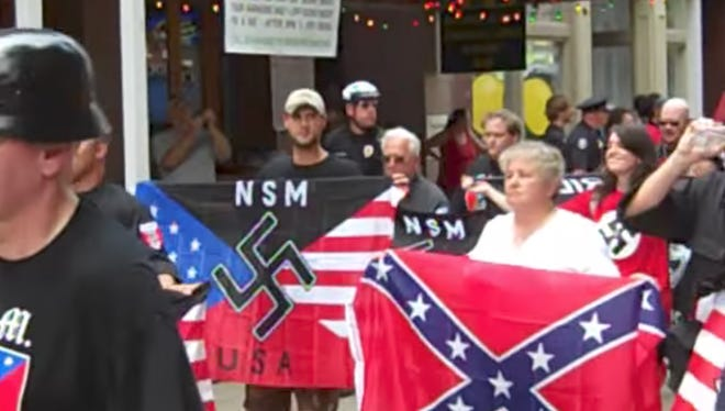 Members of the National Socialist Movement hold a rally in downtown Knoxville in 2010. The city is now preparing for a planned demonstration by a white supremacist group at a Confederate monument in Fort Sanders on Saturday.