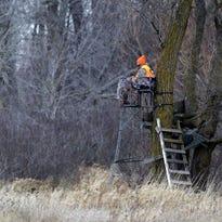 A hunter keeps watch Saturday near Chilton on the opening day of Wisconsin's gun deer season.