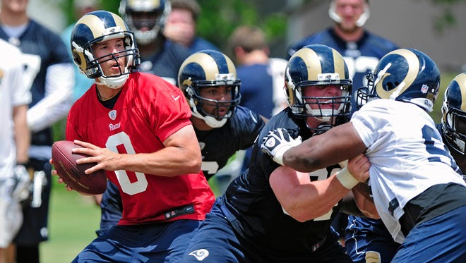 Playing behind a solid offensive line should help Rams QB Sam Bradford (8) in 2014.