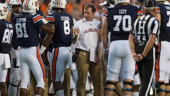 Auburn offensive coordinator Rhett Lashlee speaks to