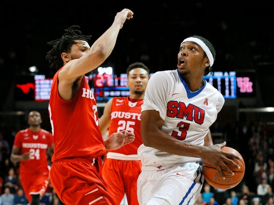 Houston guard Damyean Dotson defends as SMU guard Sterling Brown (3) positions for a shot in the second half of an NCAA college basketball game, Tuesday, Jan. 19, 2016, in Dallas. SMU won 77-73. (AP Photo/Tony Gutierrez)