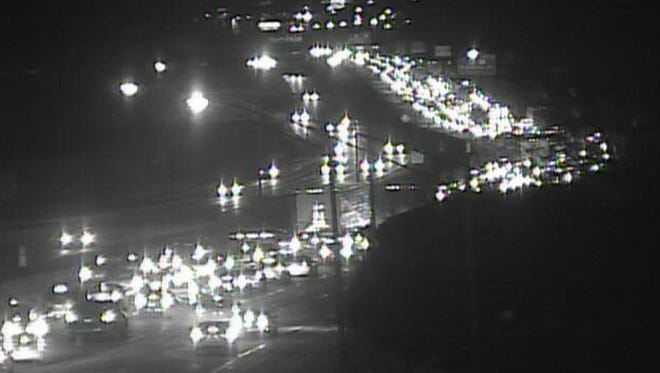 Southbound Interstate 71 completely closed Saturday night due to a wreck.