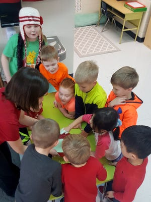 Mountain Home preschool teacher Samantha Sparks (left) works with students at the Bomber Flight Crew Extended Learning Center, an after-school program for Mountain Home Public Schools' students in grades K-2.