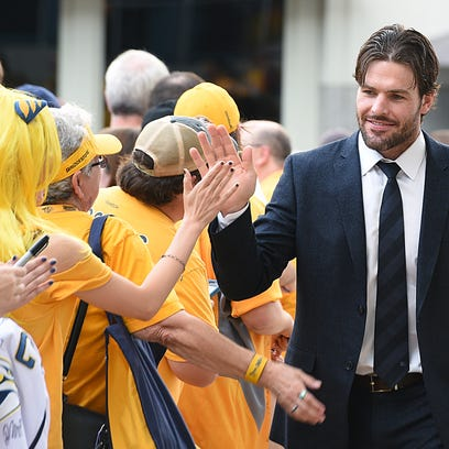 Nashville Predator Mike Fisher is greeted by fans during