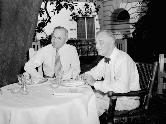 Meeting for the first time since their nominations, President Roosevelt and Harry S. Truman, Vice Presidential candidate, plan their campaigns as they lunch beneath a magnolia tree on the White House lawn August 18, 1944.