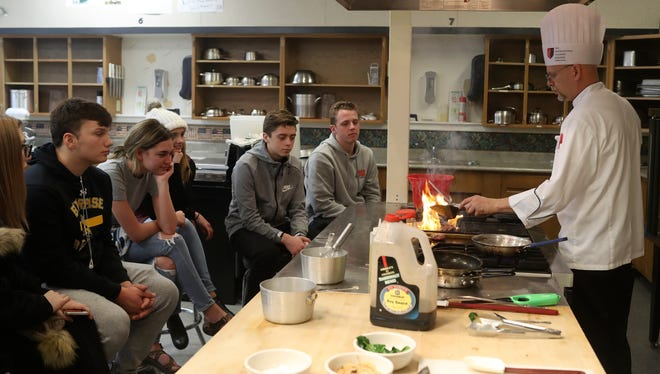 Chef James Leedy, right, teaches his culinary arts class at Enterprise High School in Redding.