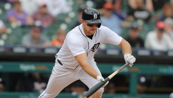 John Hicks lays down the winning bunt to score JaCoby Jones against the Rays in the 12th inning Wednesday.