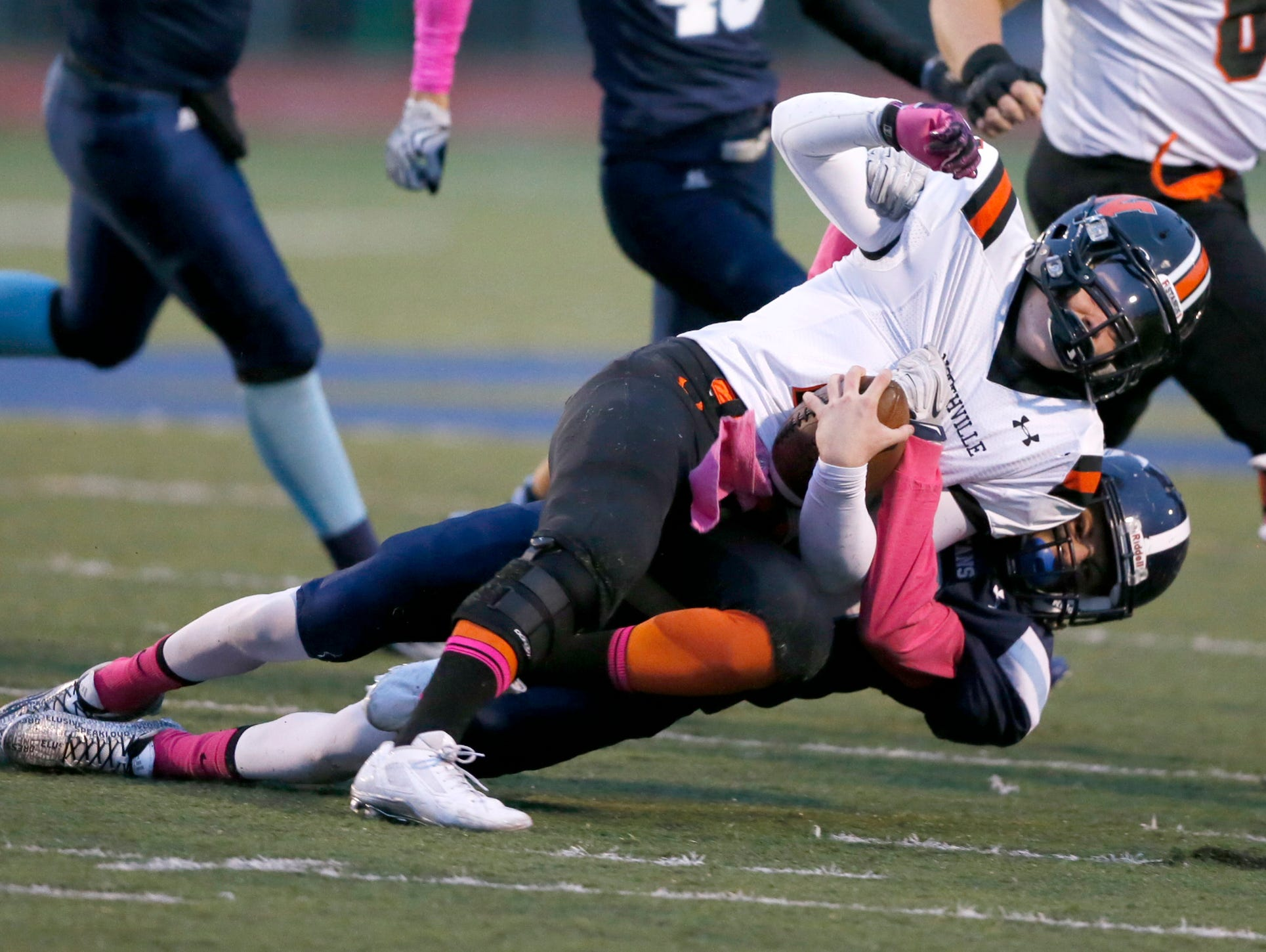 Northville's Justin Zimbo is tackled by Livonia Stevenson high school's Jack Balint at the endow a first down run in the first half of their football game on Friday, October 2, 2015, in Livonia. Julian H. Gonzalez/Detroit Free Press