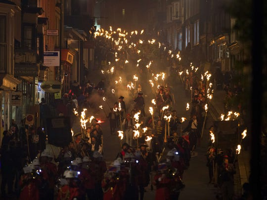 Bonfire societies parade through the streets of Lewes