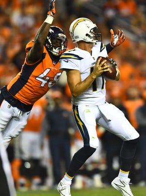 Denver Broncos linebacker Shaq Barrett, a former CSU star, sacks Los Angeles Chargers quarterback Phillip Rivers during a game Sept. 11, 2017, at Mile High Stadium in Denver.