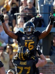 Missouri running back Damarea Crockett (16) is congratulated by Paul Adams after scoring during the first half of an NCAA college football game against Middle Tennessee, Saturday, Oct. 22, 2016, in Columbia, Mo. (AP Photo/Jeff Roberson)