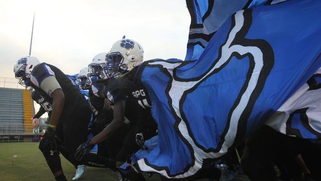 Godby football players run onto the field during a game against Trinity Christian last Thursday.