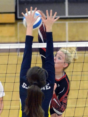 Pinckney senior Hannah Kerns spikes the volleyball in the final match of her three-year career with the Pirates.