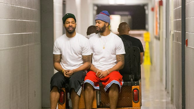 Suns forwards Marcus (left) and Markieff Morris catch a ride after emptying their lockers at the end of the season on April 15, 2015.