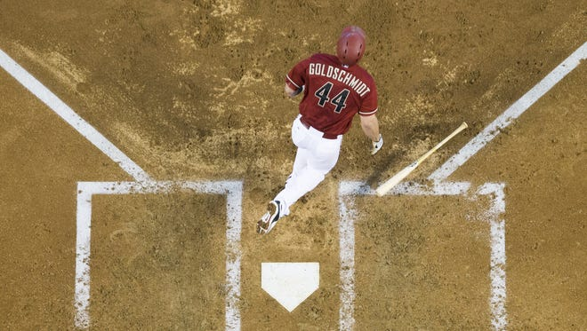 The Diamondbacks' Paul Goldschmidt watches his two-run home run to deep center field take flight against the Cubs during the third inning at Chase Field last month.