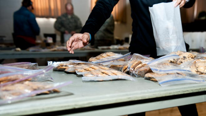 In 2014, volunteers at Holloman Air Force Base, New Mexico package cookies at the base chapel Dec. 8 as part of the annual holiday cookie drive. Members of Team Holloman and the local community baked cookies for Airmen living in the dorms on base to bring a little taste of home to those who might not be able to see their families for the holidays.