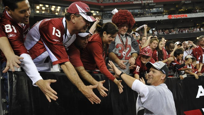Cardinals coach Ken Whisenhunt celebrates with fans after beating the Philadelphia Eagles to win the NFC Championship Game at University of Phoenix Stadium in  Glendale on Sunday,  Jan. 18, 2009.