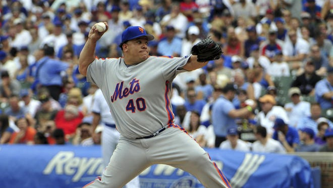 New York Mets starting pitcher Bartolo Colon (40) pitches against the Chicago Cubs during the first inning at Wrigley Field on Wednesday, July 20, 2016.