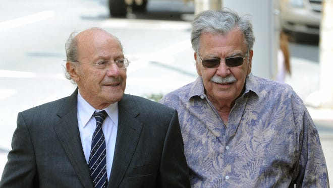 Developer Joseph L. Capano Sr. (right) makes a court appearance in 2014. Capano admitted using loan proceeds earmarked for a housing project in New Castle for personal purchases. He was sentenced Wednesday.