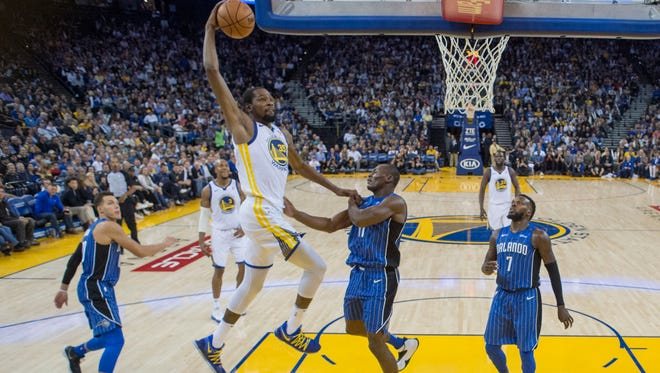 Golden State Warriors forward Kevin Durant (35) dunks the basketball against the Orlando Magic during the second half at Oracle Arena.