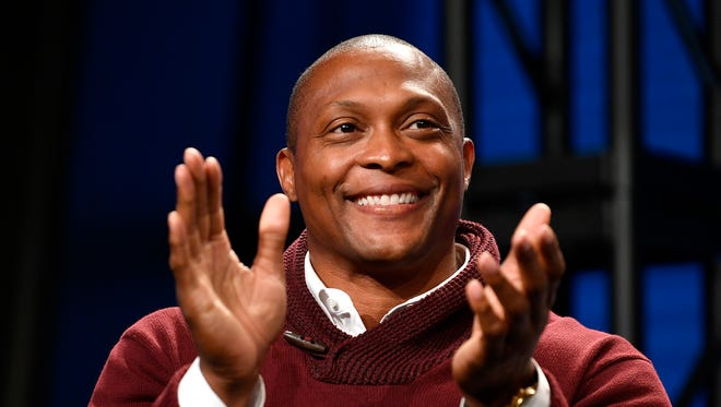 Former Titan Eddie George applauds announcement of the new Major League Soccer franchise in Nashville at the Country Music Hall of Fame Wednesday, Dec. 20, 2017, in Nashville, Tenn.