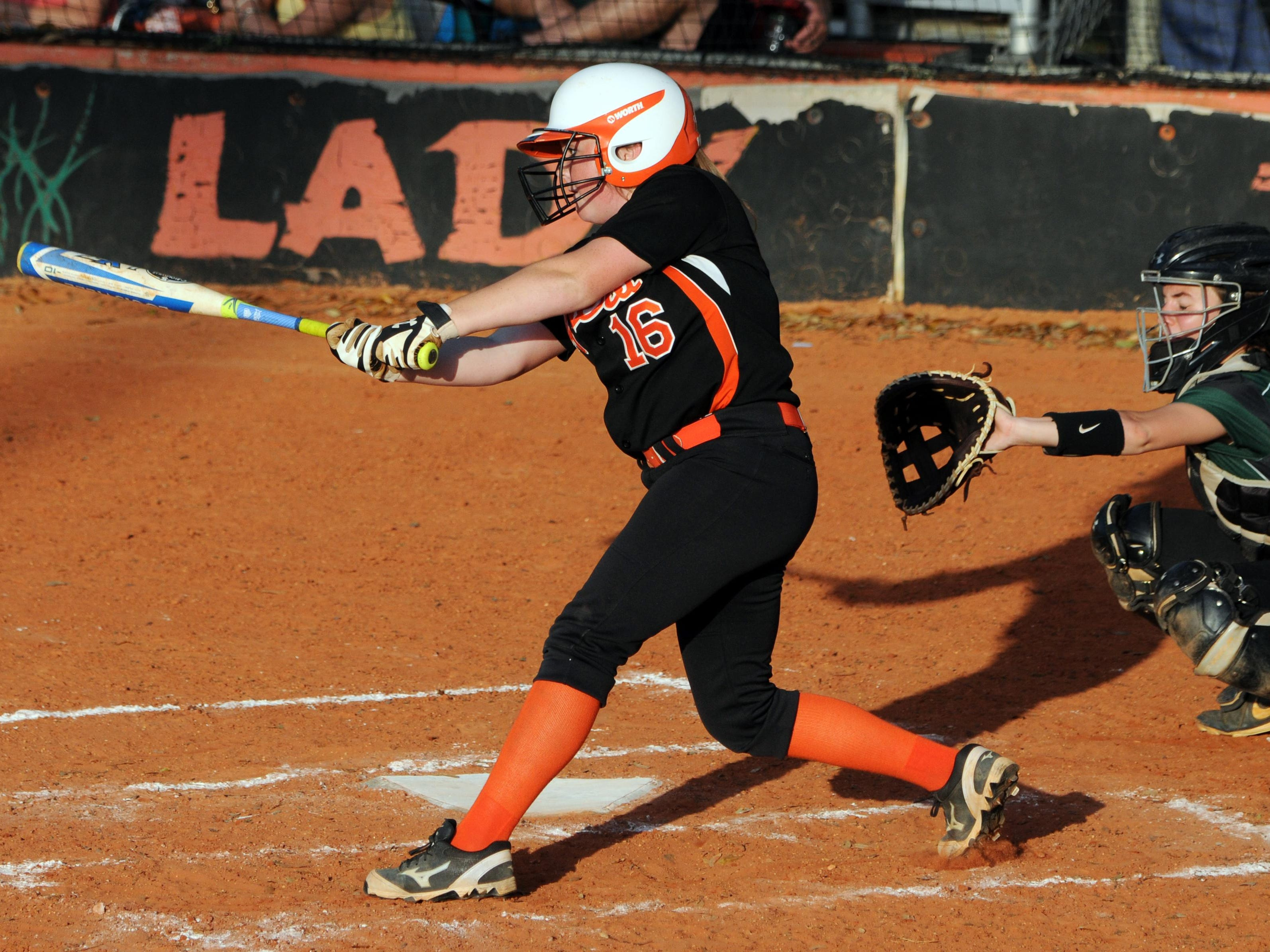 Cocoa's Savannah Pruitt puts the ball in play during Thursday's game against Melbourne.