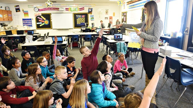 School counselor Chloe Werner follows up on a lesson on teamwork with third graders at Beattie Elementary School on Monday. Colorado, like most states, falls short of the recommended ratio of counselors to students in its public schools.