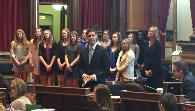 Sen. Nate Boulton, D-Des Moines, praises the Drake University women's basketball team, which stood behind him in the Iowa Senate chamber as they were honored with a Senate resolution on Thursday, April 6, 2017