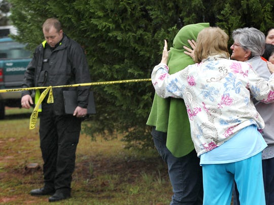 Friends and family gather outside 2217 Refuge Road in Pendleton, where four bodies were found on Nov. 2, 2015.