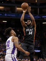 Miami Heat guard Derrick Walton Jr., right, shoots