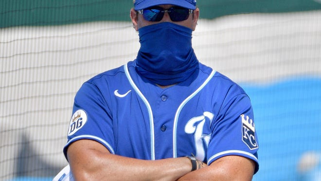 Kansas City Royals manager Mike Matheny (22) dons a face mask as he watches over a workout at Kauffman Stadium, The former Cardinals manager will see his old team in an exhibition game in St. Louis on July 22.