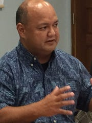 Superintendent Jon Fernandez, center, gestures as he talks about accountability in charter school funding during Friday's work session of the Guam Education Board. Also in photo are Amanda Blas, left, chairwoman of the Guam Academy Charter Schools Council, and deputy superintendent Erika Cruz, right.