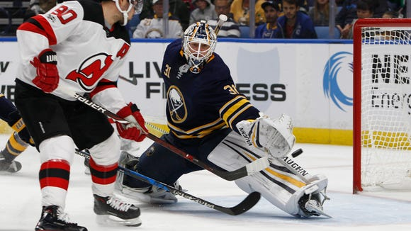 New Jersey Devils forward Marcus Johansson (90) puts the puck past Buffalo Sabres goalie Chad Johnson (31) during the second period of an NHL hockey game, Monday Oct. 9, 2017, in Buffalo, N.Y. (AP Photo/Jeffrey T. Barnes)