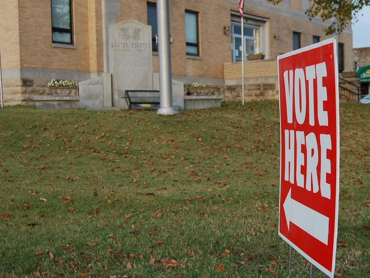 A 'Vote Here' sign points the way to the Baxter County