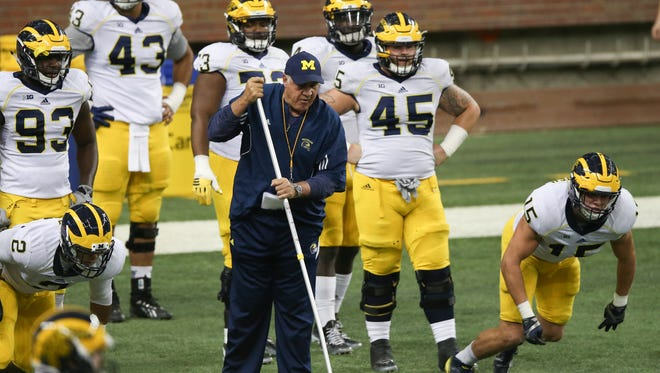 Michigan defensive line coach Greg Mattison puts his players through drills during a practice held at Ford Field on Saturday.