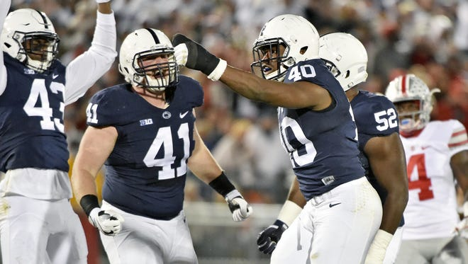 Penn State's Jason Cabinda (40) reacts after making a tackle in the first half of Saturday?s game against No. 2-ranked Ohio State. Penn State's Jason Cabinda (40) reacts after making a tackle in the first half against Ohio State.