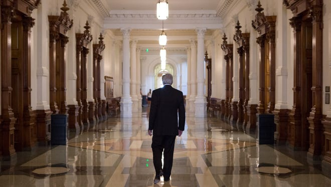 State Sen. Troy Fraser walks the first floor of the Capitol toward the dome on the last day he had meetings in the Capitol in November. His ground-floor office afforded him a view of the front steps of the Capitol, the governor's office and the south lawn.