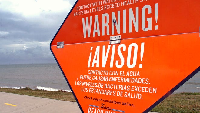 Signs by the Texas Beach Watch.com  mark areas where bacteria levels are high and may cause illness cause bacteria levels.