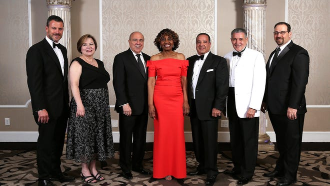 The 2017 honorees are pictured at the 33rd annual Raritan Bay Medical Center Foundation Harbor Lights Ball, from left: John Lusardi of The Liberty Group, Business of the Year; Linda Hill, executive director, Raritan Bay Medical Center Foundation; Michael R. D'Agnes, president, Raritan Bay Medical Center; Joan Harewood, Distinguished Service Award recipient; Ali Rada, Executive of the Year; Gregorio Guillen, M.D., Excellence in Medicine Award recipient; and Joseph Stampe, president, Meridian Health Foundation.