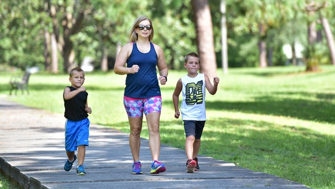 Angela Madden exercises with her sons Trace and Trent.