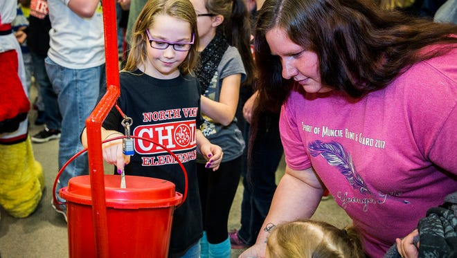 Attendees donate following the Red Kettle Campaign kick-off at the Muncie Mall Saturday afternoon. The Salvation Army is attempting to raise $160,000 for its 2018 services.