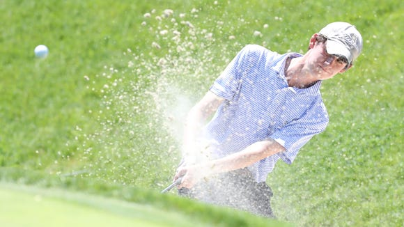 Bronxville's Dan Bettino splashes out of a bunker during the boys section 1 golf finals at Fenway Golf Club in Scarsdale on Wednesday, May 23, 2018.