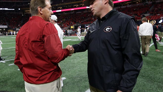 Jan 8, 2018; Atlanta, GA, USA; Alabama Crimson Tide head coach Nick Saban shakes hands with Georgia Bulldogs head coach Kirby Smart before the 2018 CFP national championship college football game at Mercedes-Benz Stadium. Mandatory Credit: Kevin Jairaj/CFP Images/Pool Photo via USA TODAY Sports
