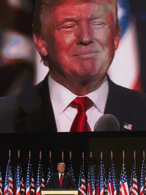 Donald Trump basks in applause before he accepts the nomination of the Republican Party on July 21, 2016, the final day of the Republican National Convention in Cleveland.