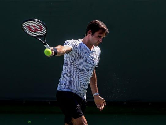 Roger Federer, of Switzerland, on practice court 1