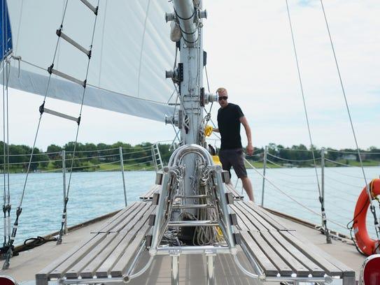 Paul Morgan, sailing mate, works to maneuver Jakab
