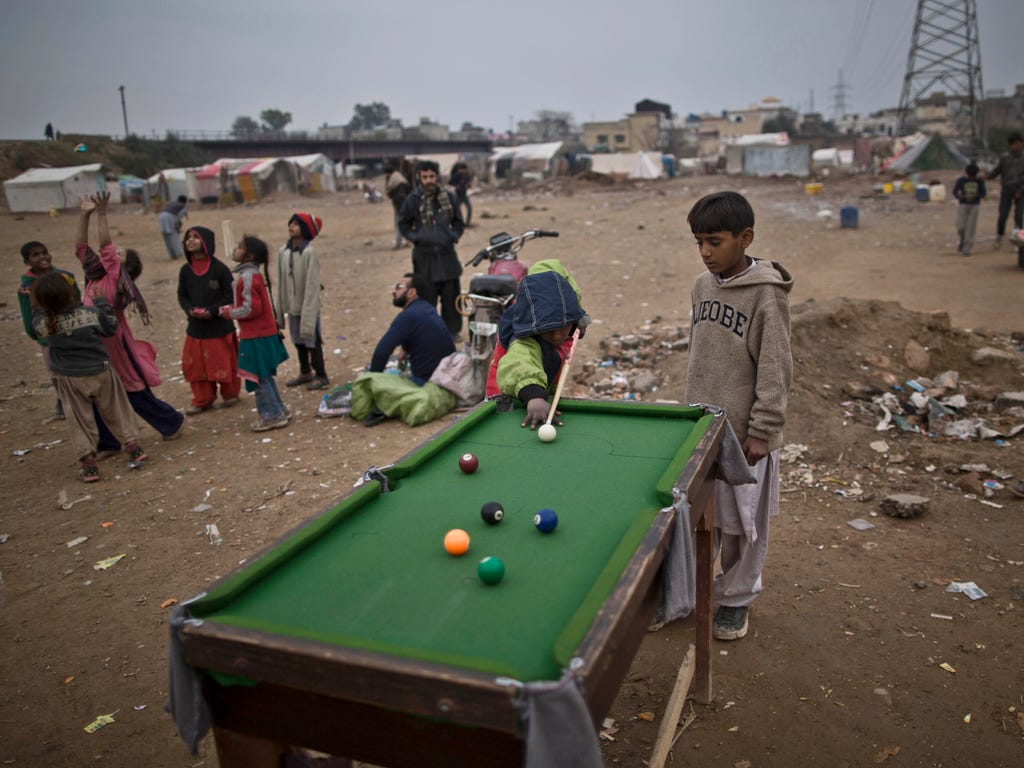 Pakistani boys plays snooker in a slum in Rawalpindi, Pakistan on Jan. 23.